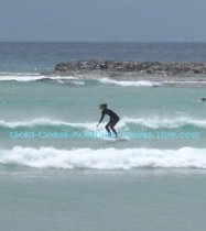 Surfing at Currumbin Alley in Gold Coast Australia is popular in February and many other times of the year.