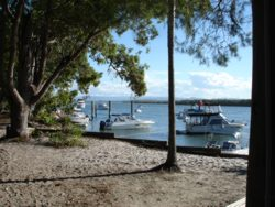 Broadwater view from South Stradbroke Island Resort showing the beach, boats anchored and the beautiful native bush.