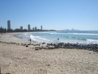View of Burleigh Beach in Winter looking back towards Surfers Paradise skyline