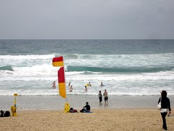 Swim between the flags on Surfers Paradise beach, or any Australian beach.