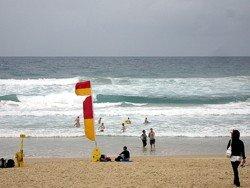 Swim between the flags on Surfers Paradise beach, or any Australian beach.