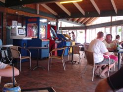 Gaming area of South Stradbroke Island Resort adjacent to the bar, restaurant and pool.